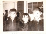 1970, Xmas Caroling at the Despres' house. L-R: Brian Kempton (edge of face peeking in), Steve Johnson, Don Montgomery,